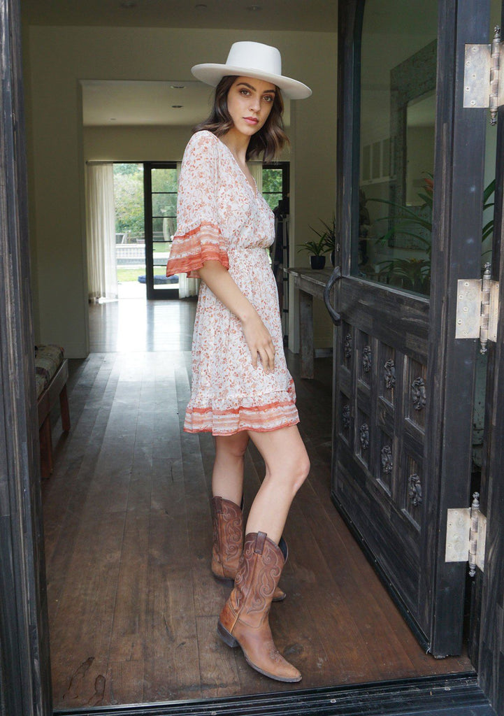 [Color: Sand Ivory] Bask in the warm glow of this bohemian mini dress with light catching metallic details throughout. A dreamy style that features short elbow length bell sleeves, a flattering surplice front neckline, and a smocked waistline for definition. A gorgeous addition to your bohemian wardrobe.
