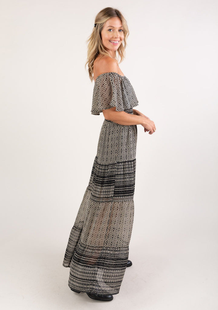 [Color: Black Cream] Bring on the romance with this gorgeous bohemian maxi dress. Featuring a charming off shoulder detail, a flirty tiered skirt, and a smocked elastic waist for definition. An ultra pretty maxi dress for brunch, picnics, or just because.