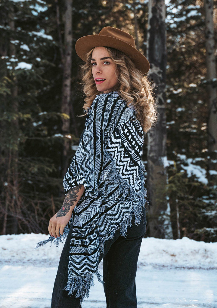 [Color: Blk/White] A bohemian cardigan with a beautiful Southwestern style pattern throughout. Featuring flattering three quarter length kimono sleeves and a fringed hemline.