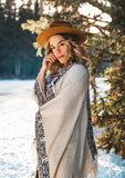 [Color: Natural/Midnight] The ultimate bohemian poncho sweater, in an eye catching Southwestern style pattern. Featuring a fringed handkerchief hemline, contrast ribbed details, and an easy open front.