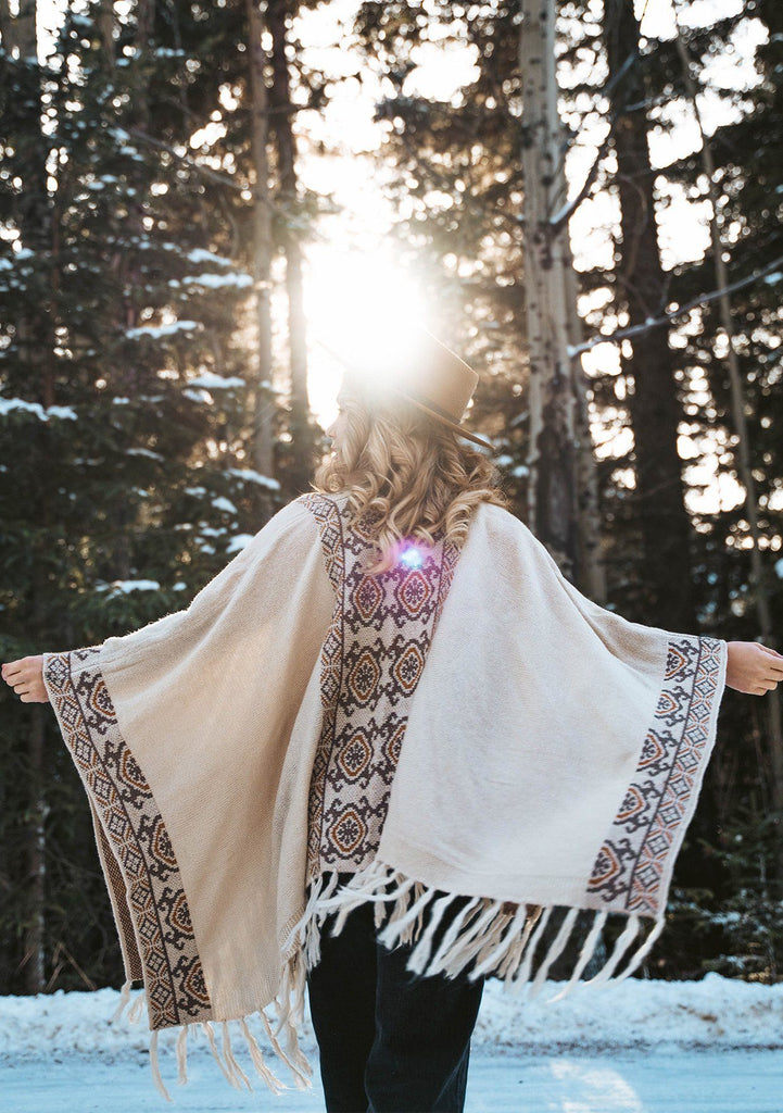 [Color: Oatmeal/Mocha] The ultimate bohemian poncho sweater, in an eye catching Southwestern style pattern. Featuring a fringed handkerchief hemline, contrast ribbed details, and an easy open front.