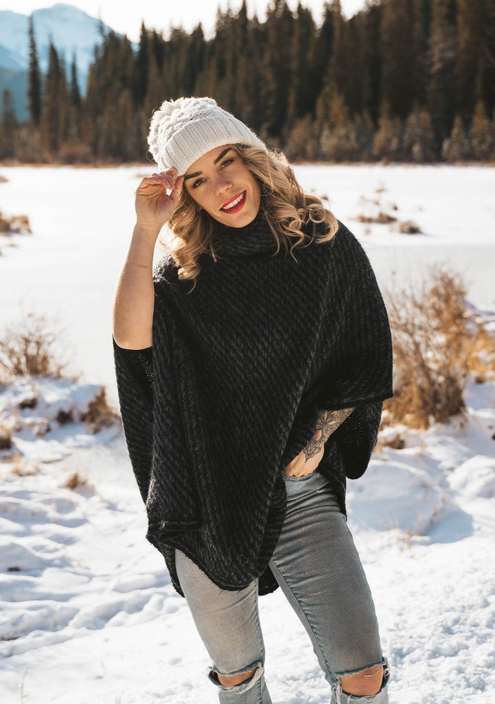 [Color: Black] An irresistibly warm and soft wool blend sweater poncho. Featuring a relaxed, oversized silhouette and a cozy cowlneck.
