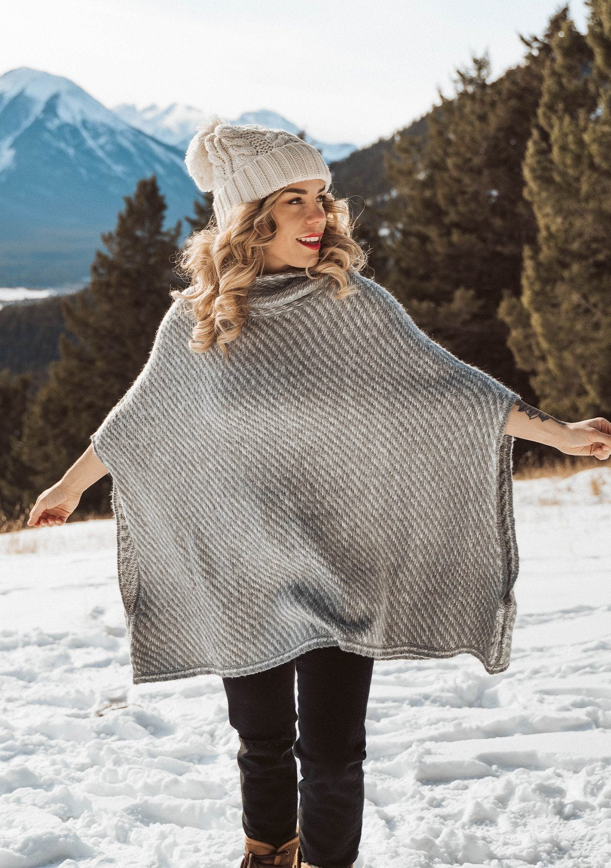 [Color: Ivory/Silver] An irresistibly warm and soft wool blend sweater poncho. Featuring a relaxed, oversized silhouette and a cozy cowlneck.