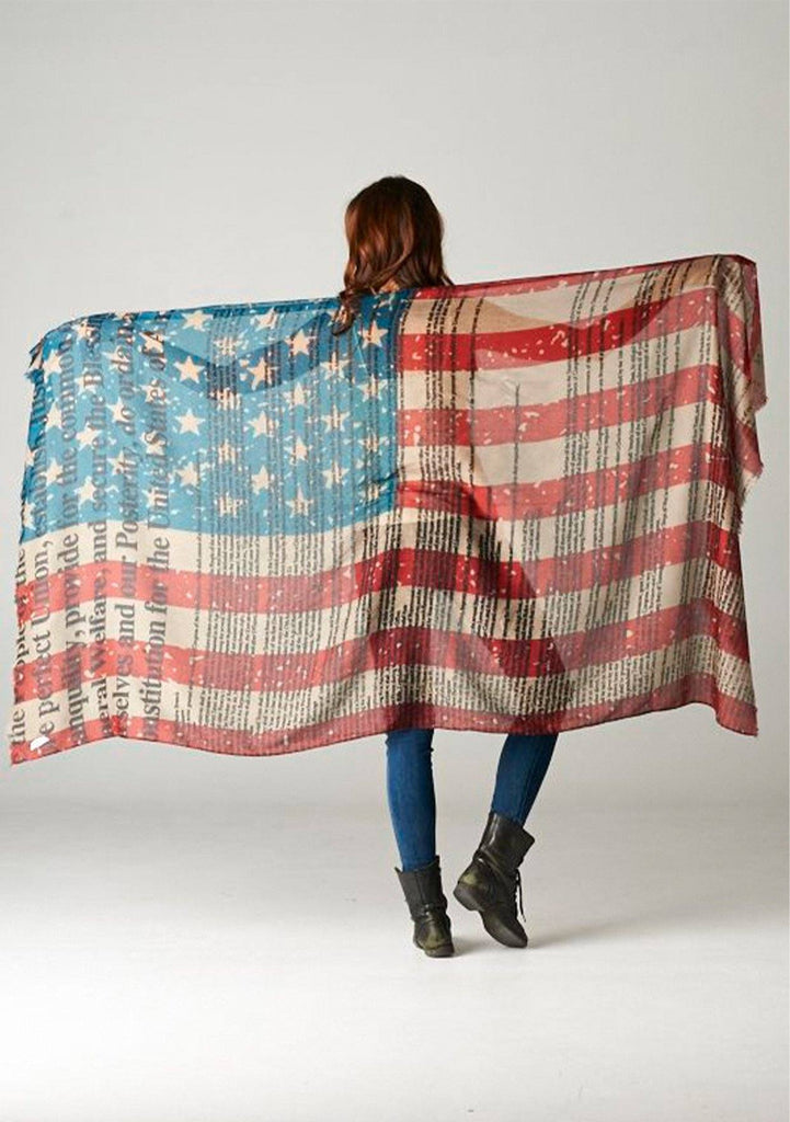[Color: Flag] We are bringing this beautiful American Flag scarf back just when you need it most! A beautiful and chic, lightweight red, white and blue scarf with the constitution printed on top. Slight distressed details add a bohemian touch. This beautiful scarf doubles as a fashionable face mask. Quarantine in style and keep yourself and others safe and healthy!