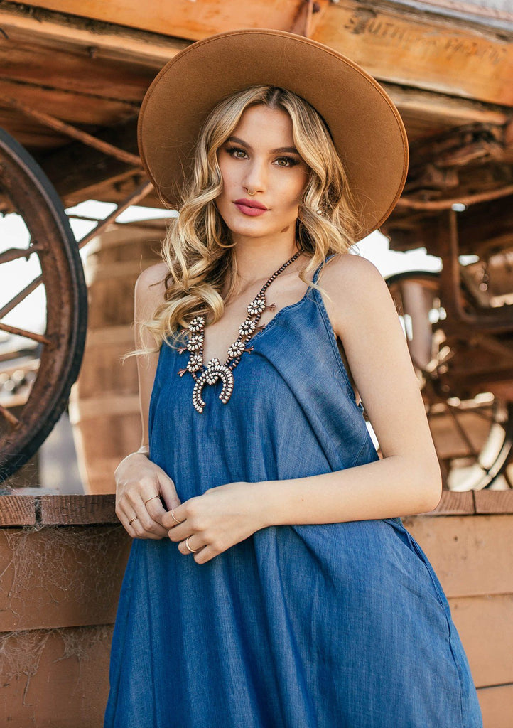 [Color: Vintage Blue] A bestseller for a reason, our harem maxi dress is a sexy yet comfortable warm weather staple. This billowy maxi tank top dress features a flattering deep v neckline, sexy spaghetti straps, and chic cocoon fit. Worn here with western style boots and hat.