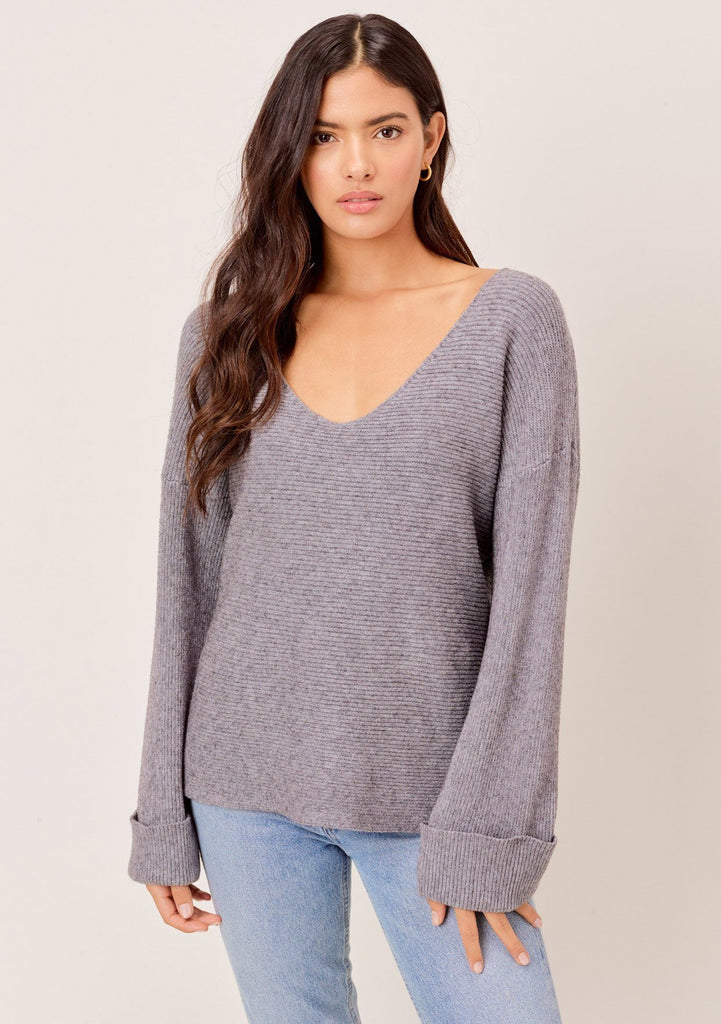 [Color: Heather Charcoal] Super soft ribbed grey sweater with a plunging v neckline and oversize cuffed sleeves. The coziest softest and cutest sweater.