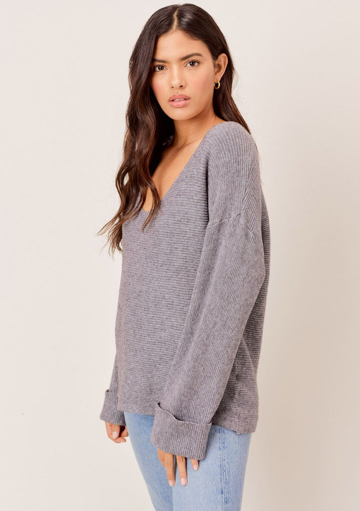 [Color: Heather Charcoal] Social distancing must have sweater. A soft and cozy ribbed sweater with deep plunge v neckline and oversize cuffed sleeves.