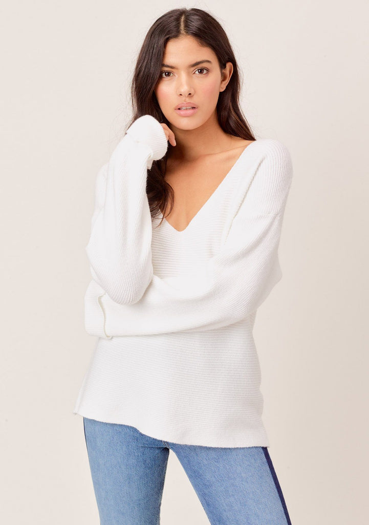 [Color: Ivory] Shop this white ribbed sweater with a plunging neckline, long oversize cuffed sleeves. The softest sweater in dreamy white ribbed fabrication, feels like cashmere. Dreamy affordable white sweater.