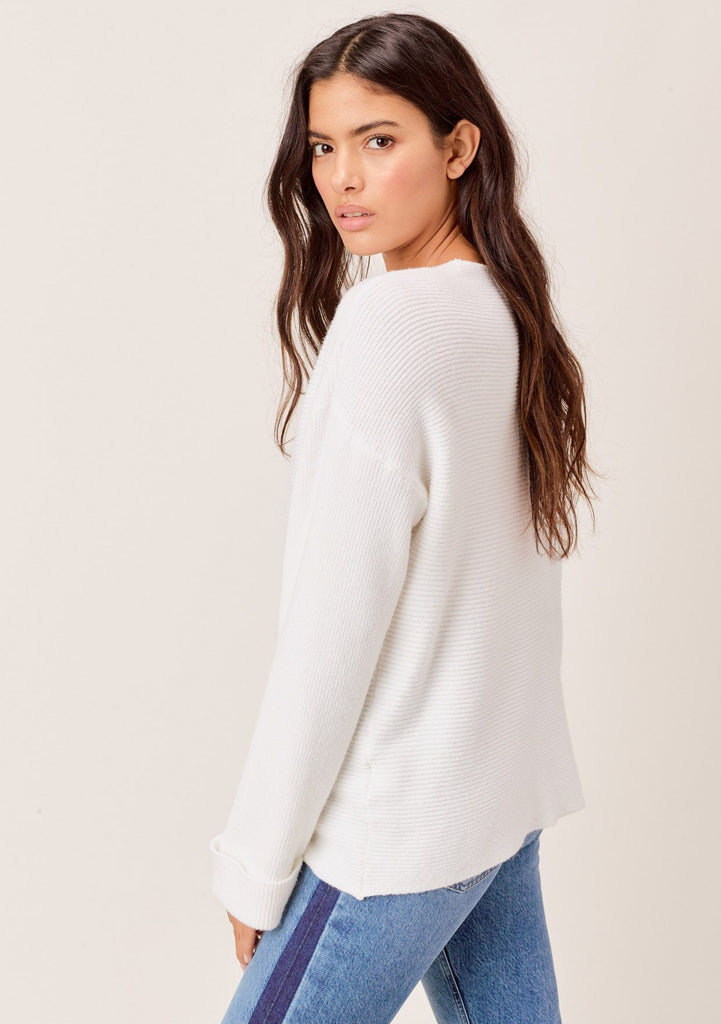[Color: Ivory] Ivory, dropped shoulder, ribbed sweater with cuff sleeves and V neckline.