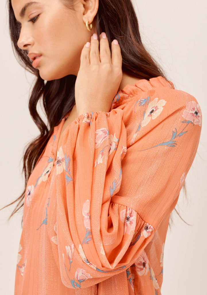 [Color: Apricot/Peach] Lovestitch apricot/peach sheer, floral printed V-neck blouse with volume balloon sleeve and tassel tie neck.