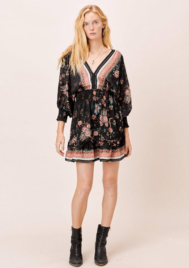 [Color: Black/Spice] A flirty open back mini dress in a floral print. Features a split sleeve detail, a smocked elastic waist and cuffs, and a tiered skirt.
