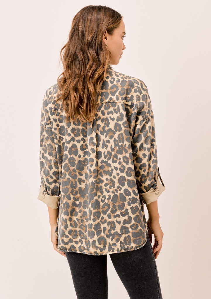 [Color: Cheetah] We are wild about this classic button up shirt in an allover cheetah print. Featuring a long sleeve with button tab closure and two front pockets. This top is both comfortable and fashionable