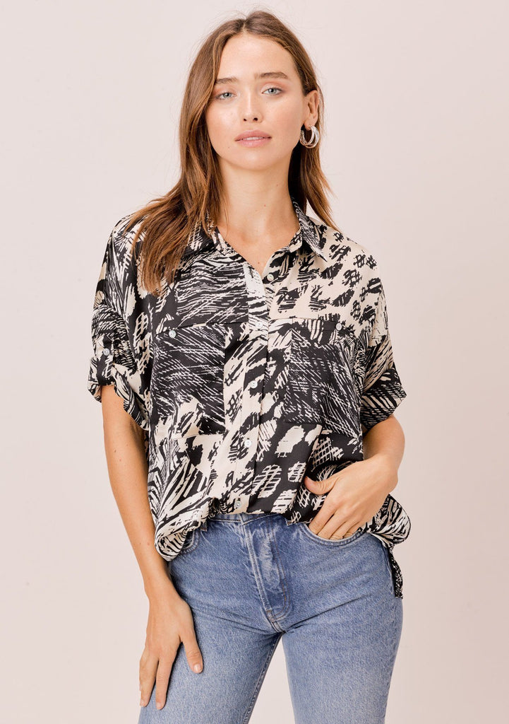 [Color: Black/Natural] Lovestitch geo printed, buttondown, short sleeve top with cuffed sleeves.