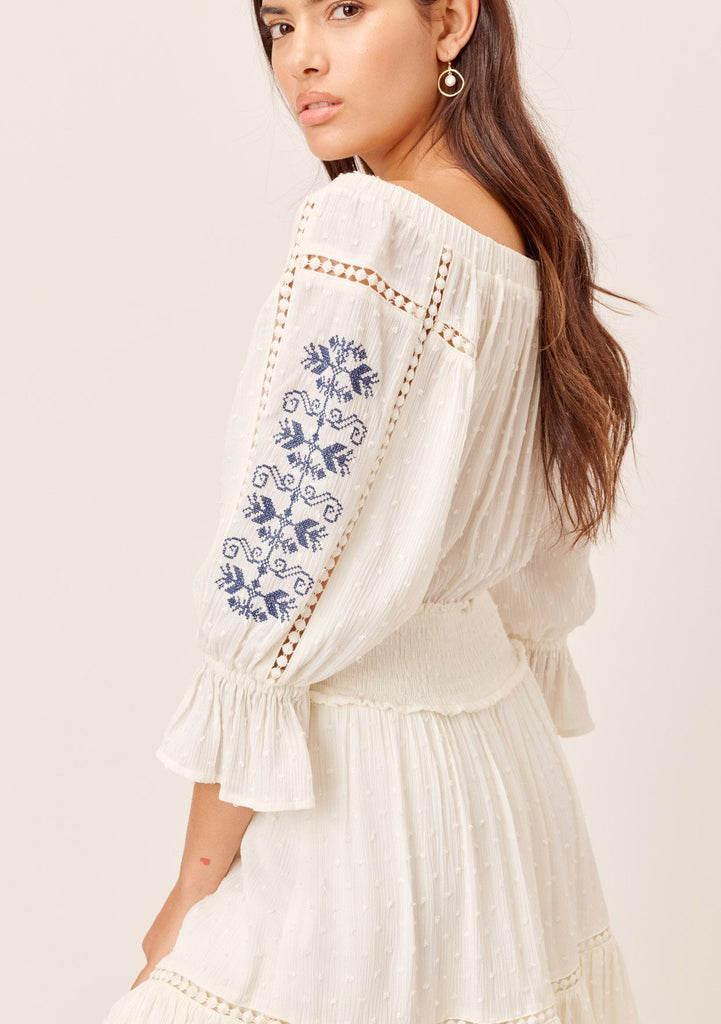 [Color: OffWhite/Multi] Lovestitch offwhite/multi Beautifully embroidered, off-the-shoulder mini dress with smocked waist and lattice inserts.