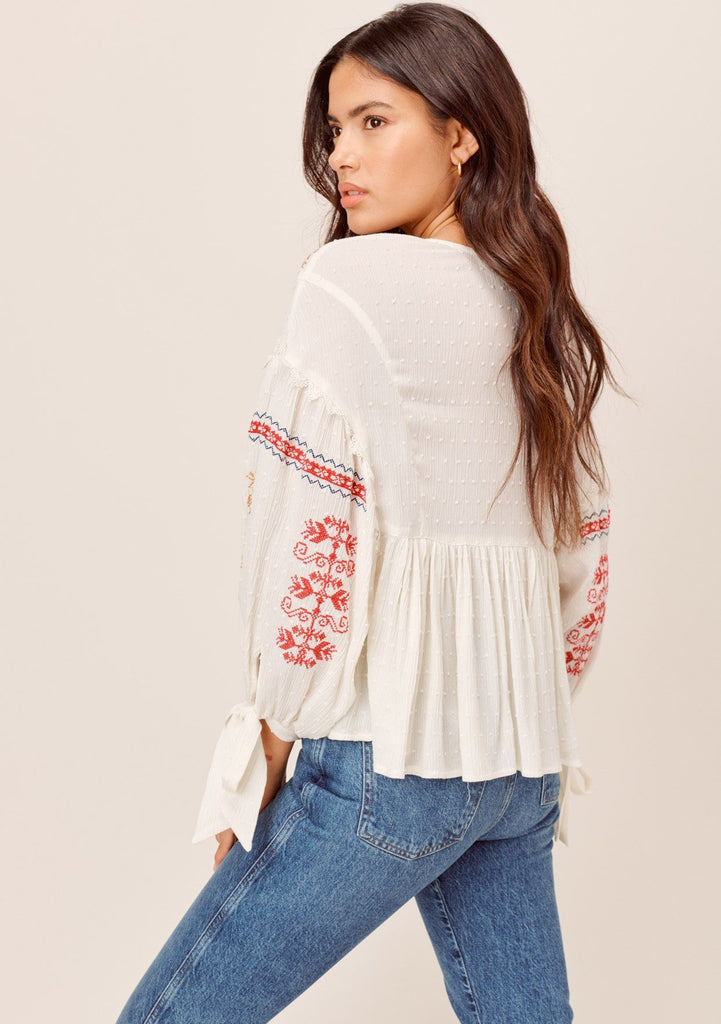 [Color: OffWhite/Multi] Lovestitch offwhite/multi Beautiful intricate embroideries are the ultimate touch to this bohemian chic V-neck baby doll blouse. Featuring embroidered volume sleeves, Swiss-dot texture throughout, tie-cuff sleeves, and a cute baby-doll silhouette.