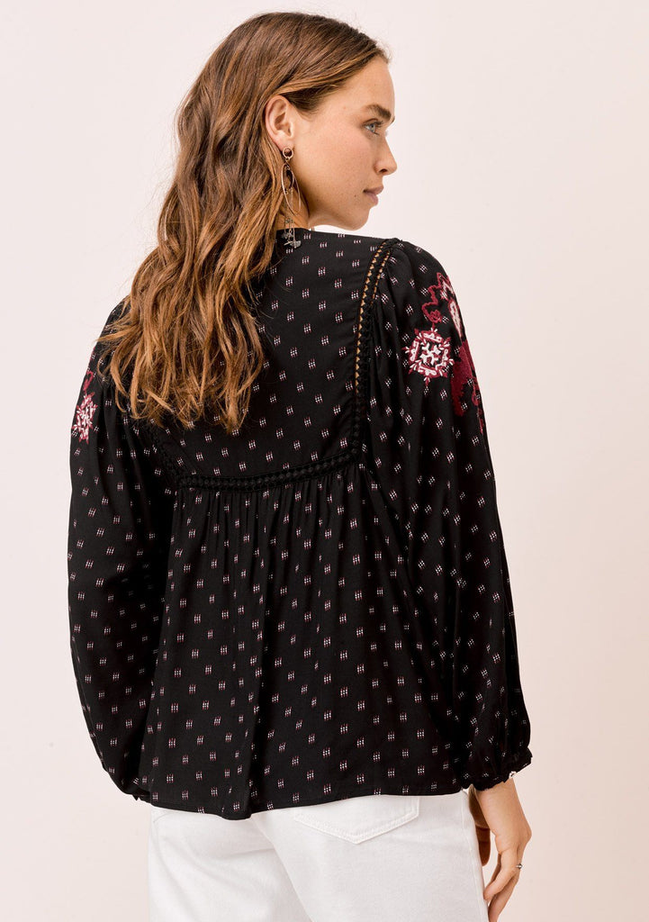 [Color: Black/Merlot] Lovestitch black/merlot embroidered top with lattice inserts and tassel tie neck