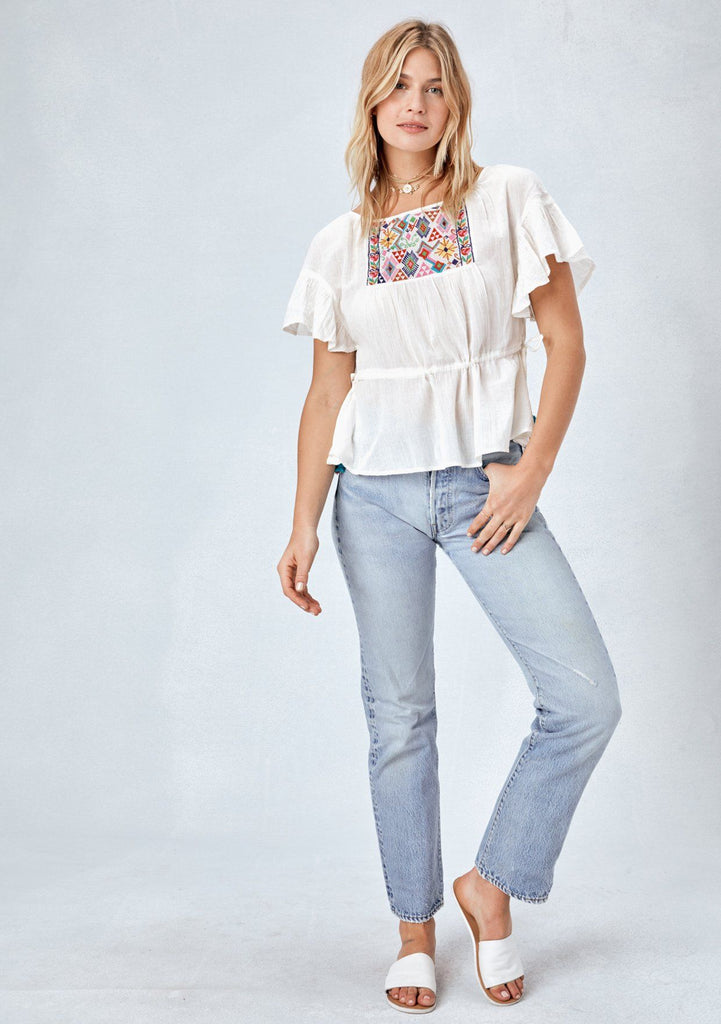 [Color: OffWhite/Multi] Lovestitch white, lightweight cotton, short sleeve top featuring flutter sleeve, beautifully embroidered front and drawstring cinched waist with pom-pom tie detail at side.