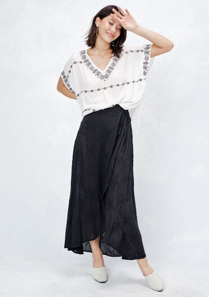[Color: Black] Our embroidered eyelet, crinkle gauze wrap skirt features a side tie detail. Made from a slightly sheer and lightweight fabric, we recommend wearing it with a slip or by itself over a swimsuit at the beach!