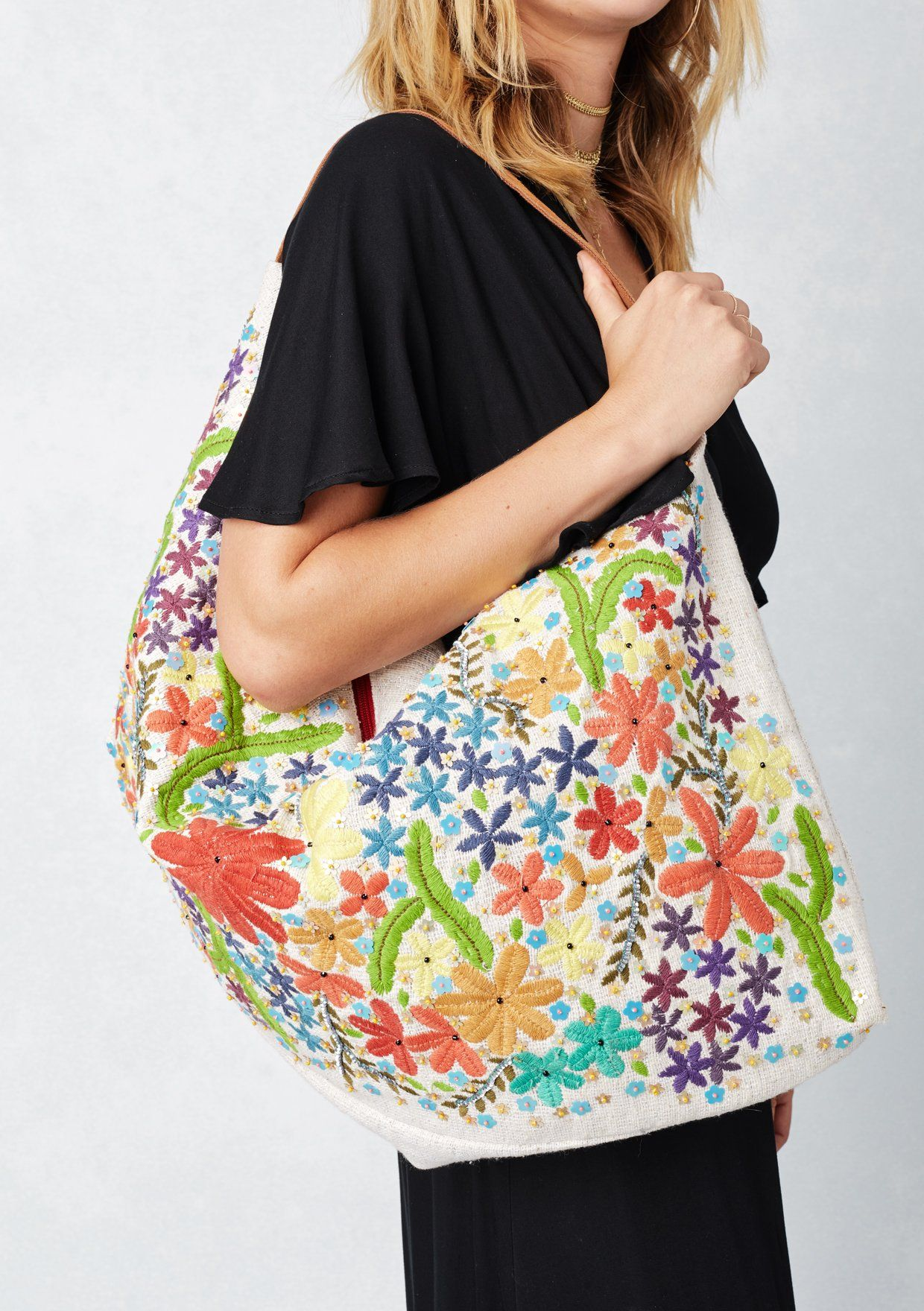 [Color: Multi/Natural] Lovestitch Intricately beaded, floral embroidered, oblong hobo bag, with suede handle and zippered closure.