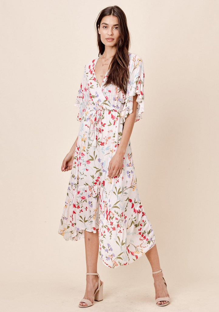 [Color: Vanilla Floral] Lovestitch white floral printed maxi dress with angled, ruffled sleeve and tie front detail.