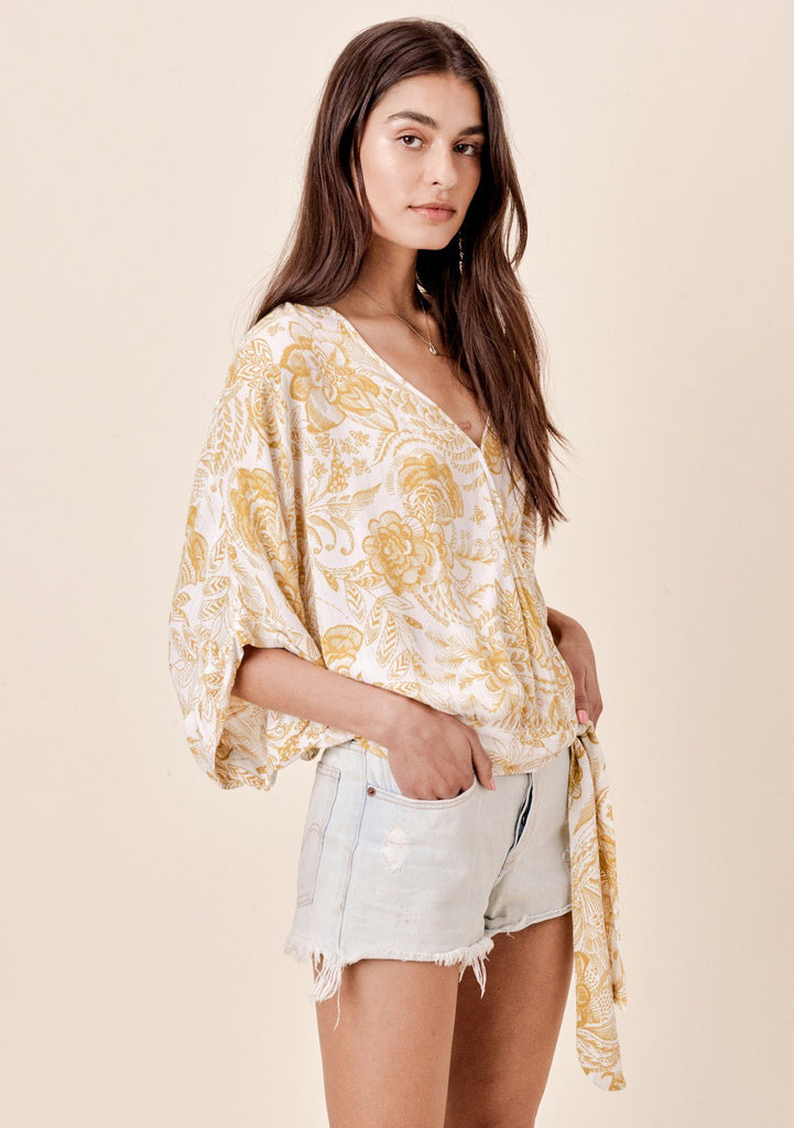 [Color: Mustard] Lovestitch hand-sketched floral printed top with wrap front and side tie detail.