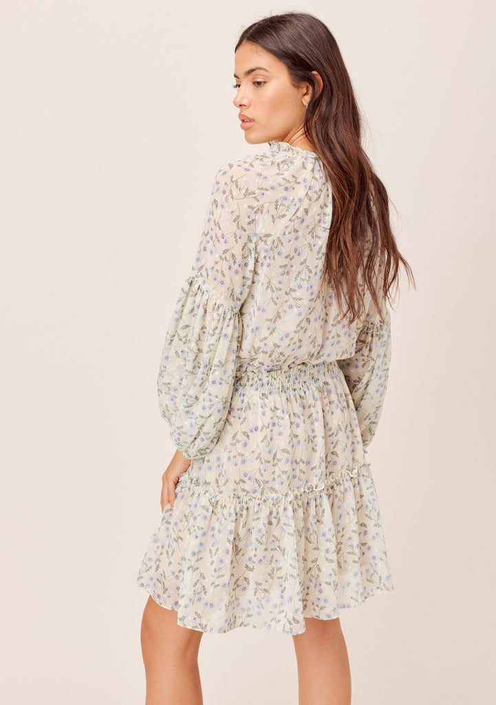 [Color: Cream/Sky] Lovestitch cream/sky Floral printed, smocked waist mini dress with volume sleeves and tassel tie neck.