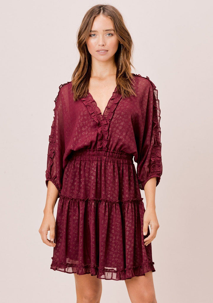 [Color: Wine/Gold] A foil chiffon mini dress, featuring a ruffle trimmed v neckline in front and back, ruffle trimmed three quarter length sleeves, and a tiered skirt.