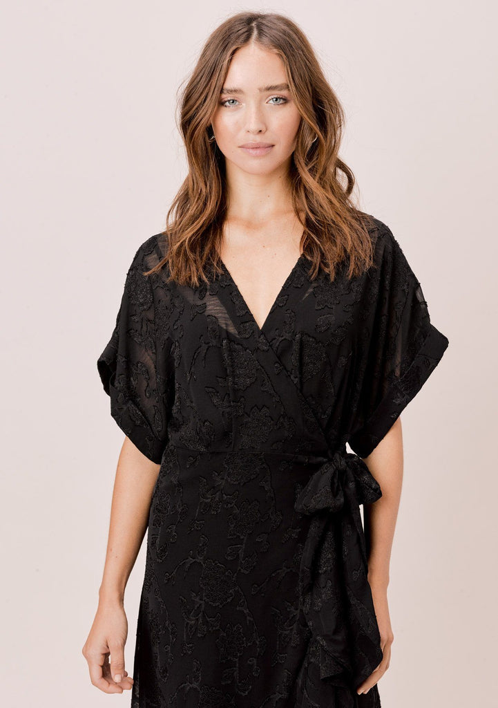 [Color: Black] Lovestitch black beautiful, floral jacquard chiffon wrap dress with ruffled high low hem.