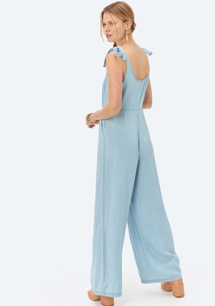 [Color: Heritage Blue] Lovestitch light blue, wide-leg, sleeveless, tencel jumpsuit with tie shoulder detail and buttoned top.