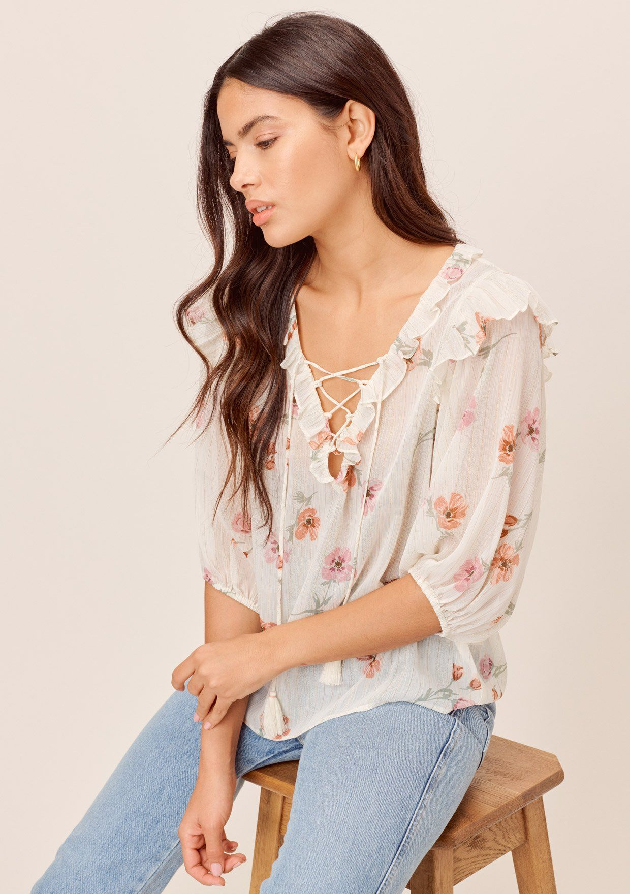 [Color: Ivory/Peach] Lovestitch ivory/peach Floral printed, lace-up front top with ruffled details and tassel ties.