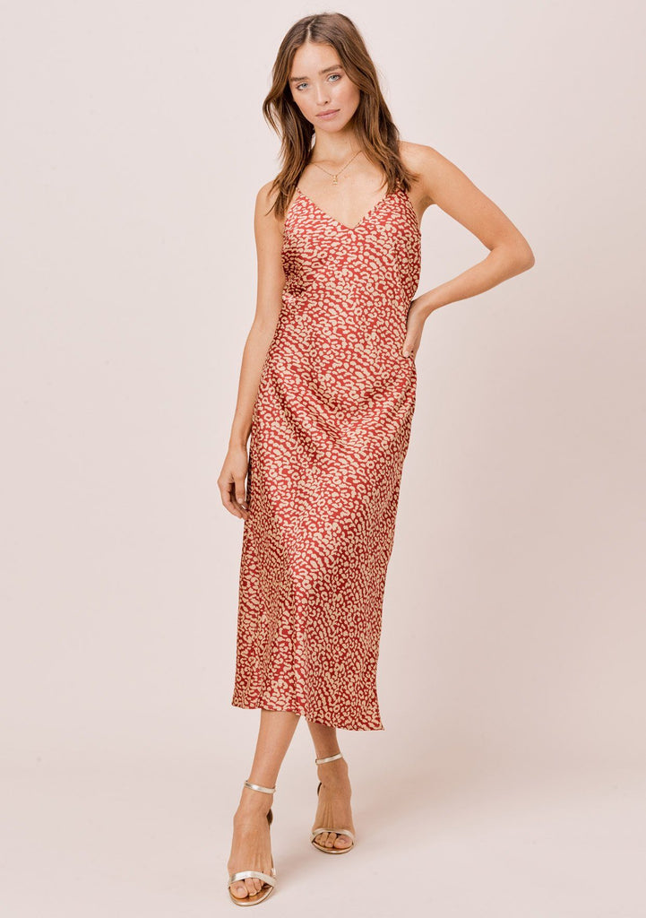 [Color: Rust/Sand] Lovestitch rust/sand leopard printed, bias cut midi dress with gorgeous criss-cross back detail.
