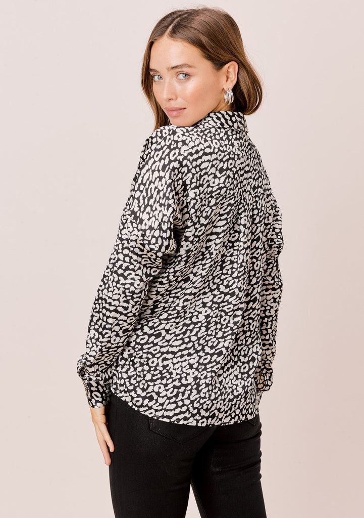 [Color: Black/Ivory] Lovestitch black/ivory long sleeve, leopard printed, knot front, collared top.