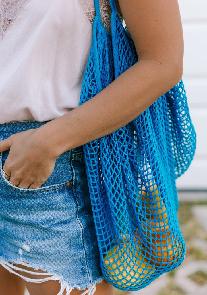 [Color: Blue] The perfect mesh net tote for carrying your produce at the grocery store or farmers market. Bright beautiful blue cotton stretch net tote bag from Lovestitch