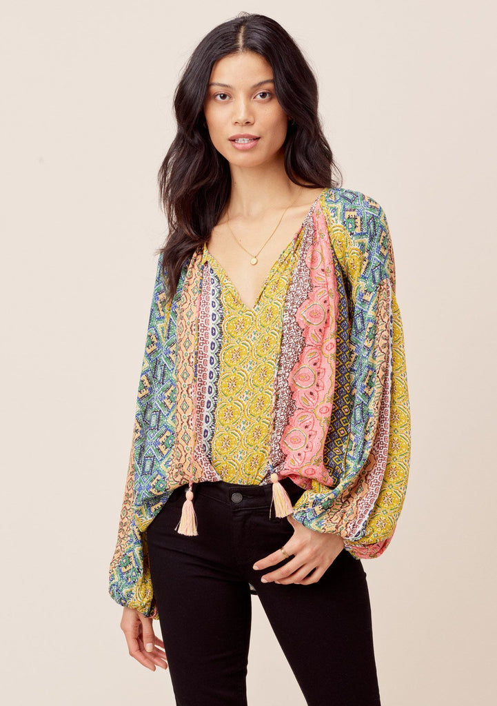 [Color: Multi] Lovestitch Beautiful, vibrant Marrakesh colored volume sleeve peasant blouse with metallic details and tassel tie neck. Pretty colorful hippie blouse