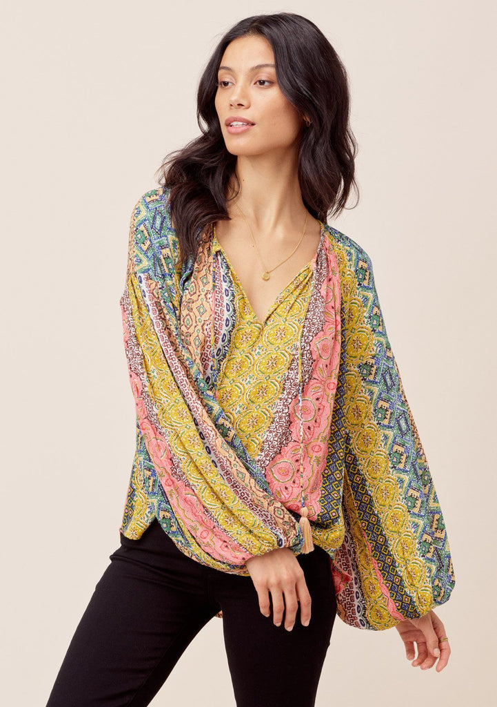 [Color: Multi] Lovestitch Beautiful, vibrant Marrakesh colored volume sleeve peasant blouse with metallic details and tassel tie neck. Shop elegant bohemian style women's clothing.