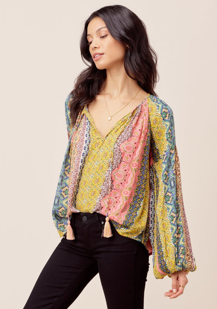 [Color: Multi] Lovestitch Beautiful, vibrant Marrakesh colored volume sleeve peasant blouse with metallic details and tassel tie neck. Shop elegant bohemian style blouse