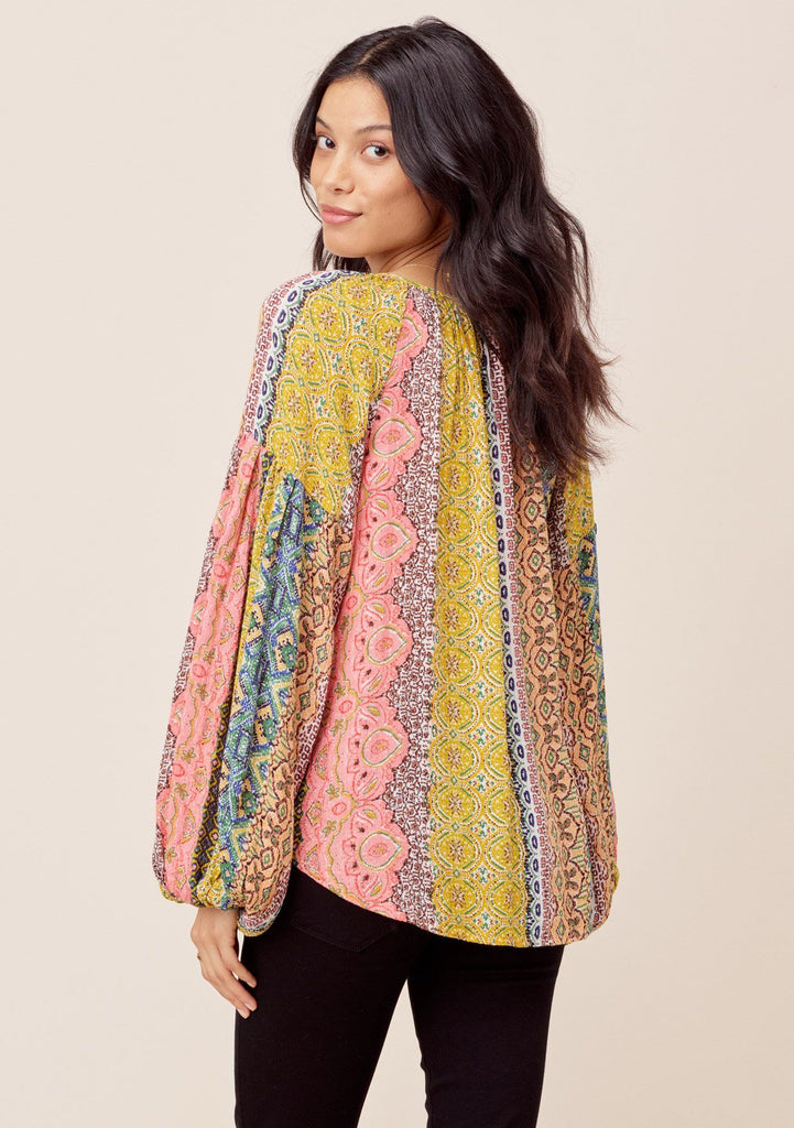 [Color: Multi] Lovestitch Beautiful, vibrant Marrakesh colored volume sleeve peasant blouse with metallic details and tassel tie neck. Stunning vibrant hippie style peasant blouse with flattering sleeves