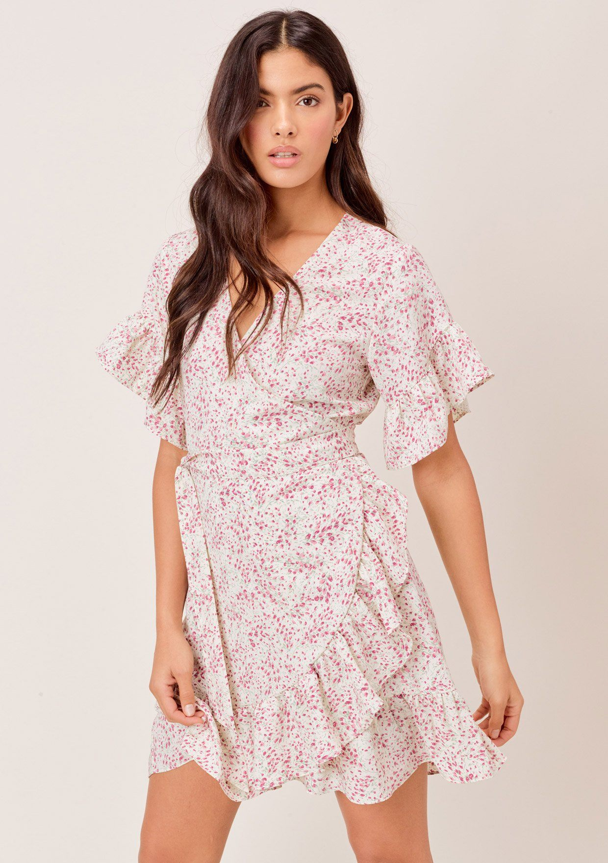 [Color: Ivory/Orchid] Lovestitch The pretty and adorable pink mini tulip floral short sleeve wrap dress featuring tiered ruffled hem and flattering ruffled butterfly sleeves.
