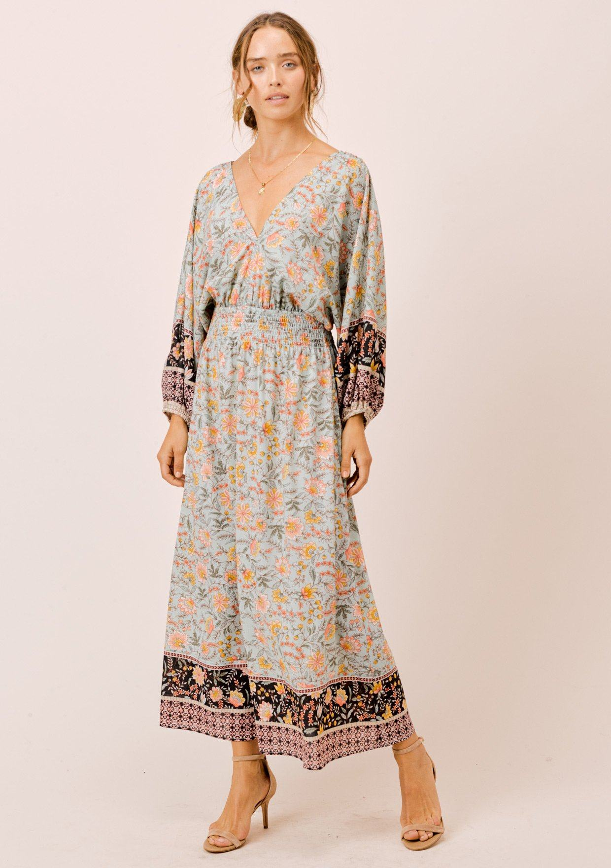 [Color: Mint] Lovestitch relaxed fit light blue floral long volume sleeve maxi dress with a flattering smocked waist, V-neckline and open tie-back detail. The perfect casual dreamy maxi dress.