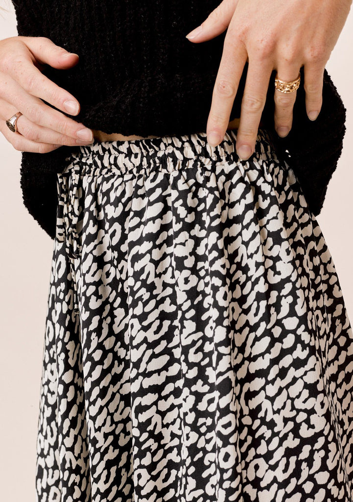 [Color: Black/Ivory] Lovestitch Animal Print Overlap Panel Handkerchief Skirt