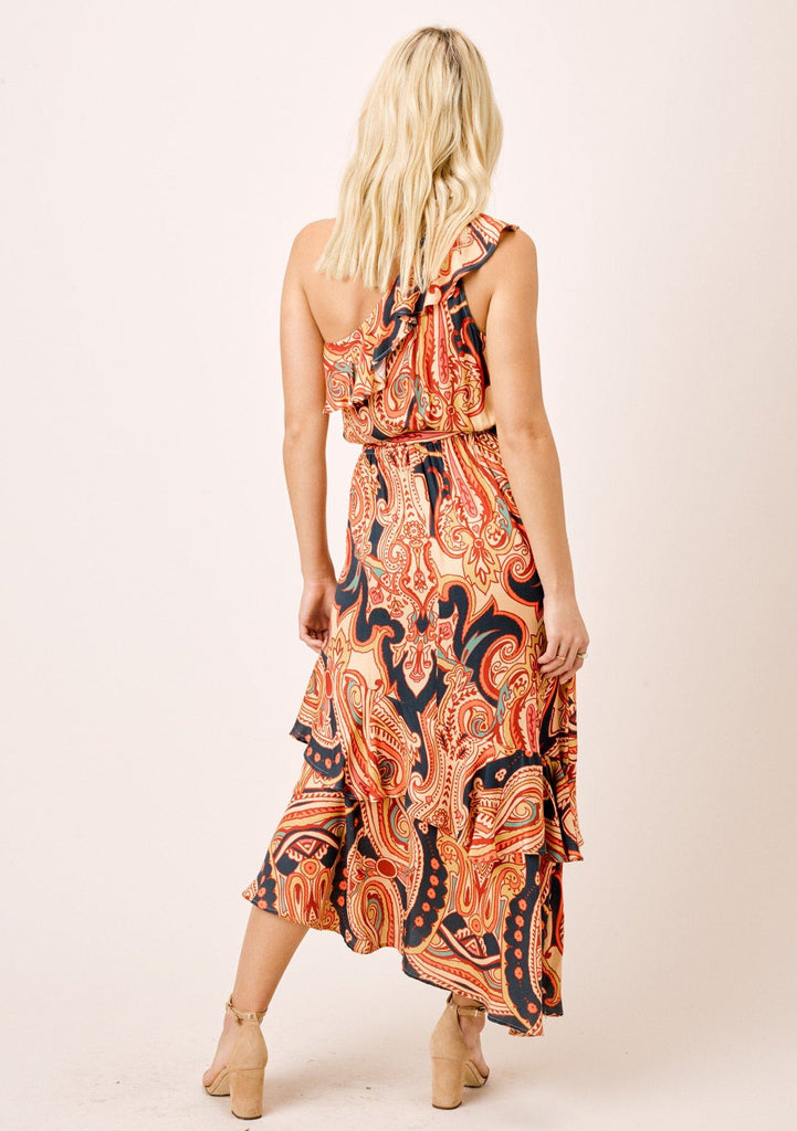 [Color: Sand/Spice] Geo paisley printed, one shoulder maxi dress with asymmetrical ruffle hem.