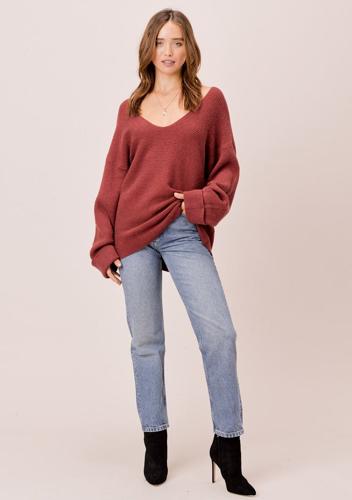 [Color: Brick] Brick red, dropped shoulder, ribbed sweater with cuff sleeves and V neckline. The perfect plunging neckline cozy red sweater with oversize sleeves.