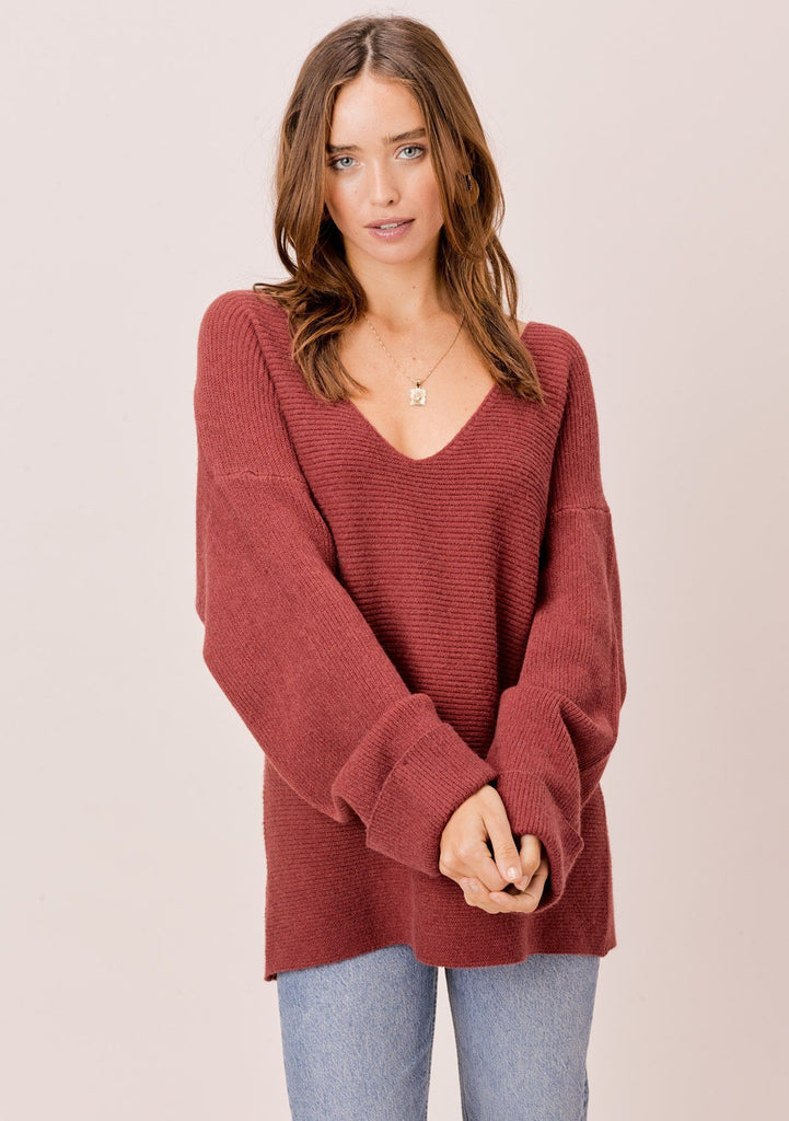 [Color: Brick] Red sweater. Ultra cozy slouchy dropped shoulder V neck sweater with long oversize sleeves and cuff sleeves. The slouchy silhouette and deep V neckline is flattering on all body types. Cozy up with your coffee this weekend in our most comfortable slouchy sweater! The perfect work from home sweater!