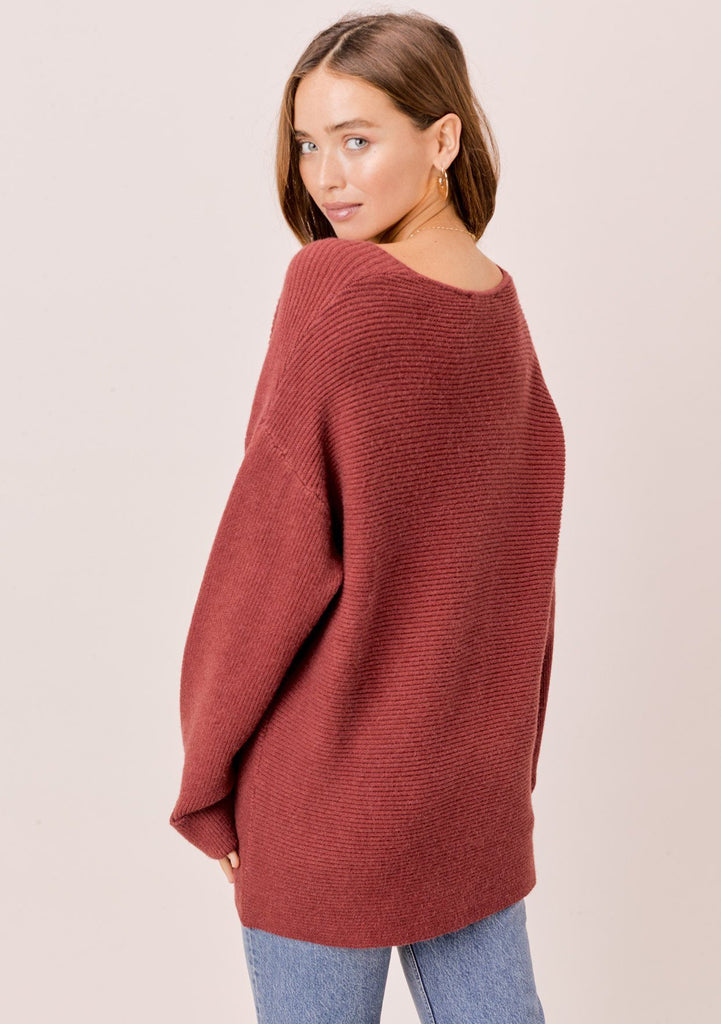 [Color: Brick] Brick red, dropped shoulder, ribbed sweater with cuff sleeves and V neckline.
