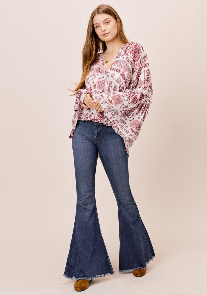 [Color: Oatmeal/Rose] Lovestitch Paisley printed, surplice top with ruffled neckline and dramatic bell sleeves.