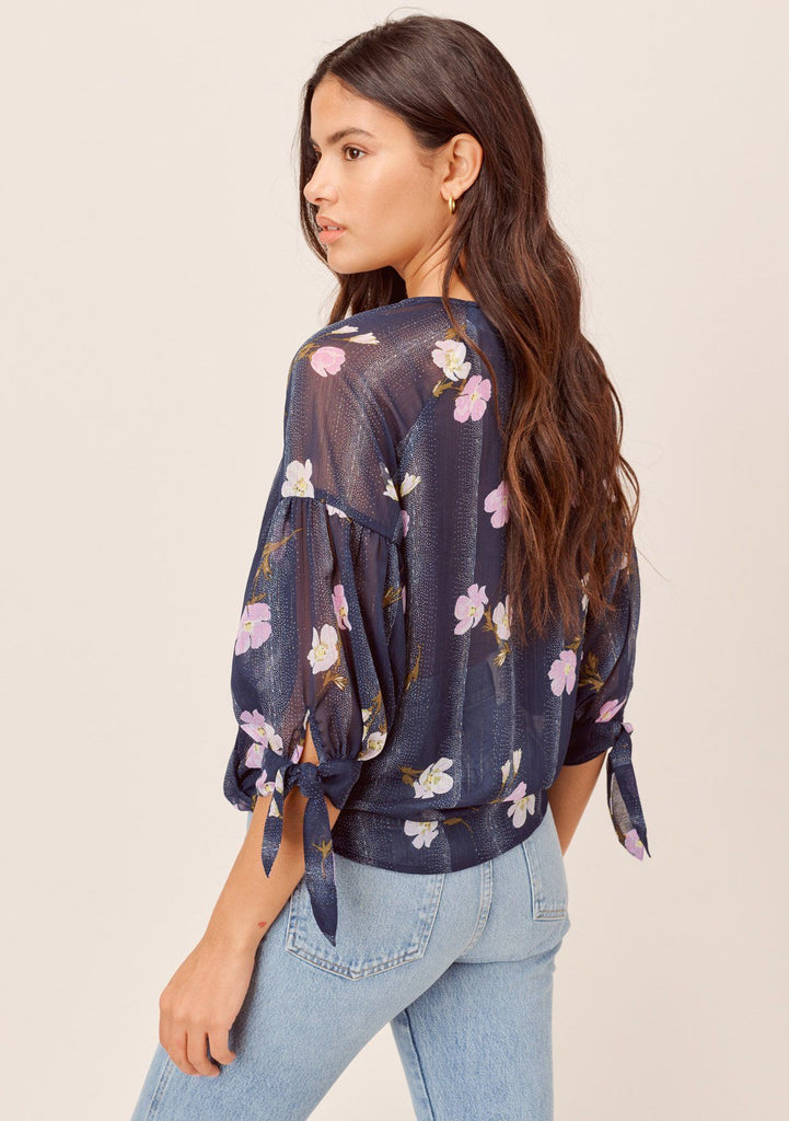 [Color: Navy/Lilac] Lovestitch navy/lilac Sheer, floral printed surplice top with elbow length balloon sleeve with tie sleeve detail.