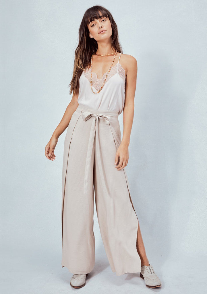 [Color: Taupe] Lovestitch taupe, textured rayon jacquard, wide leg, wrap front pant with high side slits and front tie detail.