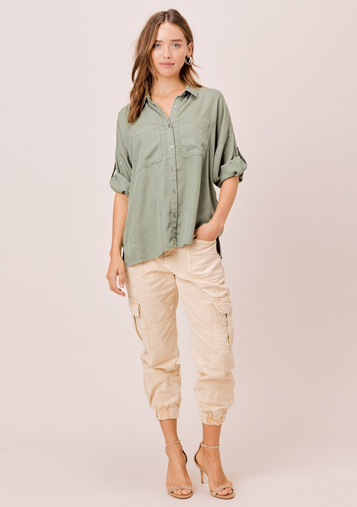 [Color: Olive] Lovestitch olive short sleeve, tencel, buttondown shirt with roll tab sleeves and paint splatter detail.