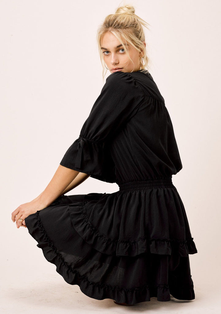 [Color: Black] Lovestitch black midi dress with tiered and ruffled detail.