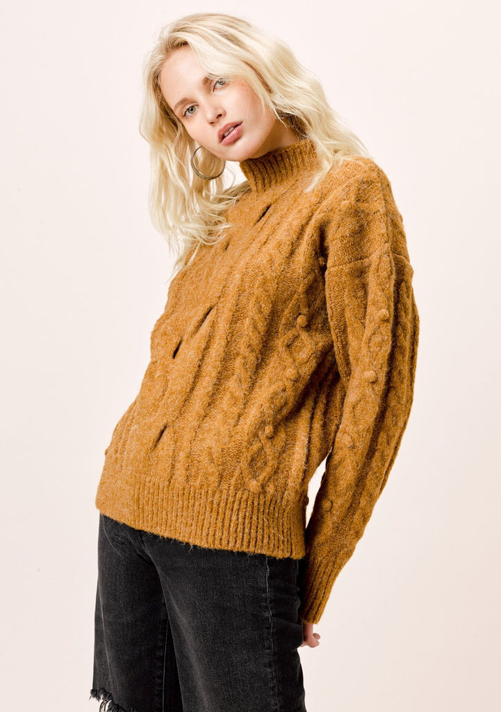 [Color: Tobacco] Long sleeve, tobacco brown , cable knit, mock neck sweater with pom-pom details.